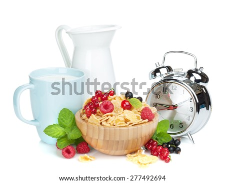 Fresh corn flakes with berries, milk jug, cup and alarm clock. Isolated on white background - stock photo
