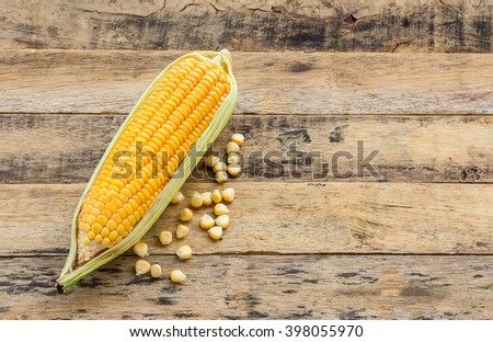 Fresh corn on a wooden table background - stock photo