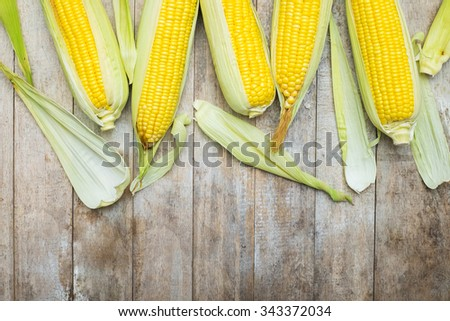 Fresh corn on rustic wooden table, - stock photo