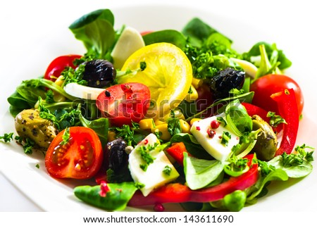fresh corn salad on white plate and white background