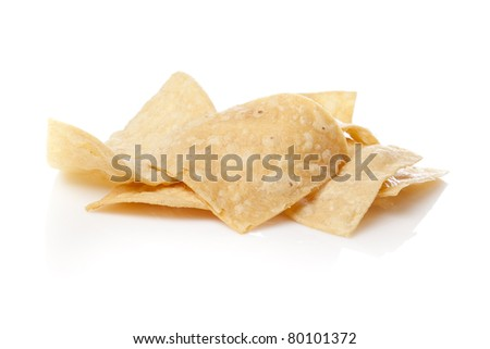 Fresh corn tortilla chips against a white background - stock photo
