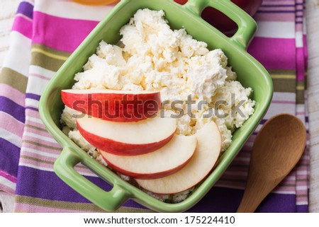 Fresh cottage cheese  in bowl with apple.  Rustic style. Bio/organic/natural ingredients. Healthy eating. - stock photo