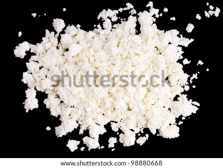 Fresh cottage cheese on black background. - stock photo