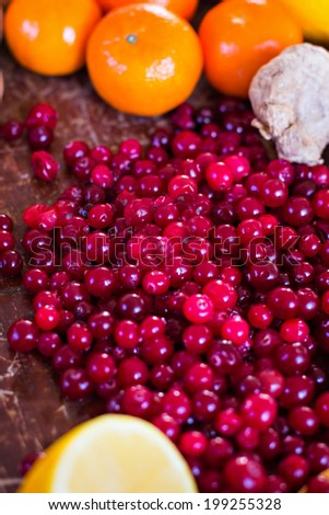 Fresh cranberries and other fruits on the table - stock photo