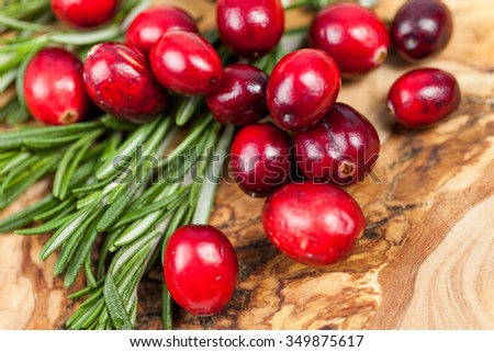 Fresh cranberry (cowberry) on wooden board