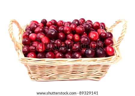 fresh cranberry in the wicker basket made in studio isolated on white background