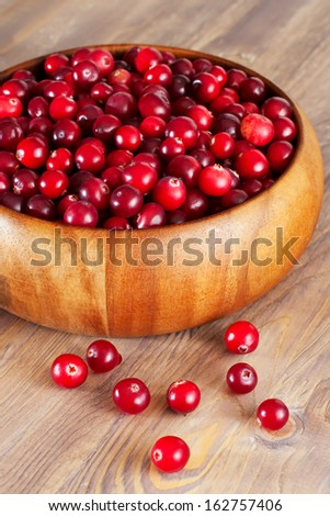 Fresh cranberry in wooden bowl
