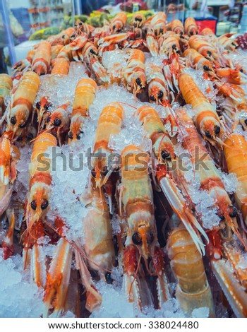 Fresh crayfish in the fish section. Seafood in the market - stock photo