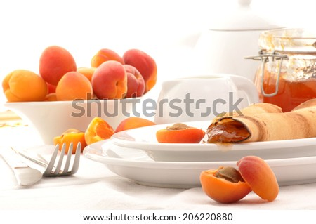 Fresh crepes with homemade apricot jam - stock photo