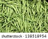 Fresh crisp green beans grown locally in a farmer's vegetable garden and displayed for sale at a neighborhood market in town. - stock photo