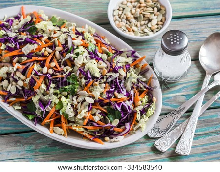 Fresh crispy vegetable salad with red cabbage, carrots, sweet peppers, herbs and seeds. Healthy food, rustic style