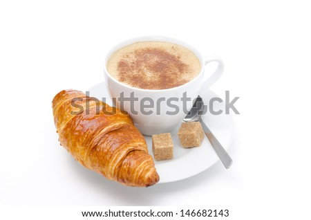 fresh croissant and cup of cappuccino with brown sugar isolated on white