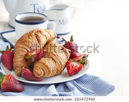 Fresh croissants and cup of tea.