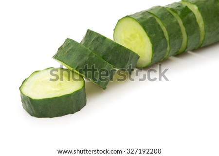 fresh cucumber slices on a white background