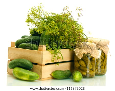 fresh cucumbers in wooden box, pickles and dill isolated on white - stock photo
