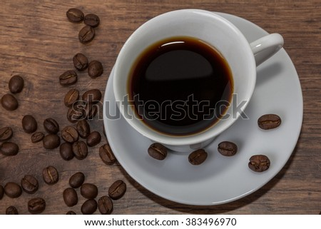 Fresh cup of arabic coffee with aromatic coffee beans, close up