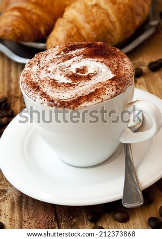Fresh Cup of Cappuccino Coffee with Croissants - stock photo