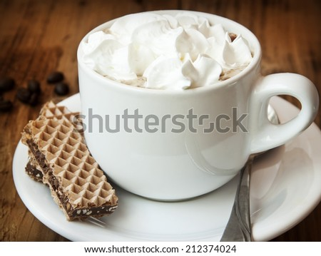 Fresh Cup of Cappuccino Coffee with Softy Cream and Chocolate Cookies