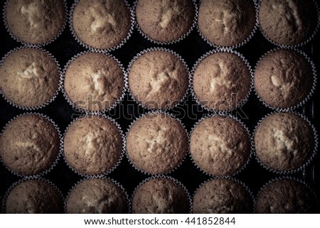 Fresh cupcake desert before decoration. Top view. Toned. - stock photo