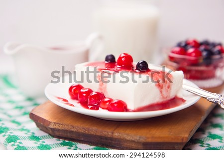 fresh curd with cherry, currant and sweet sauce on white plate