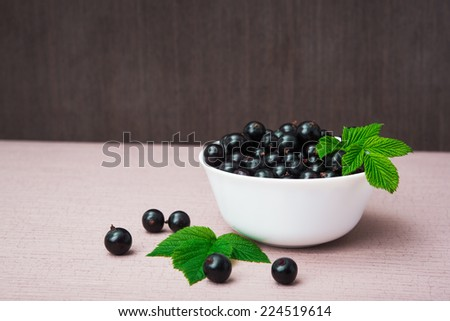 fresh currant berry with green leaf - stock photo