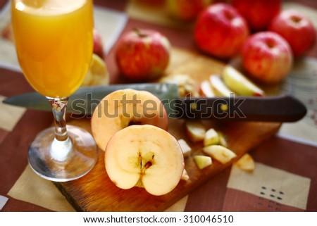 fresh cut apples prepare for cider  - stock photo