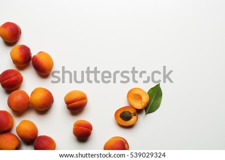 Fresh cut apricot fruits on white background