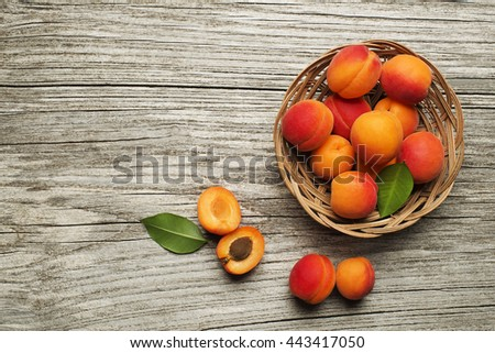 Fresh cut apricot fruits on wooden background