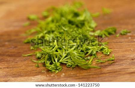 Fresh cut dill on wooden table