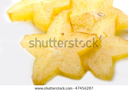 Fresh cut exotic tropical star fruit slices