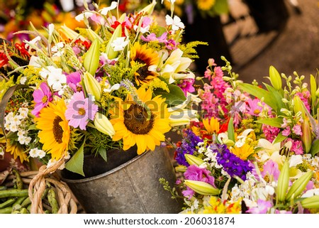 Fresh cut flowers on sale at the local farmers market. - stock photo