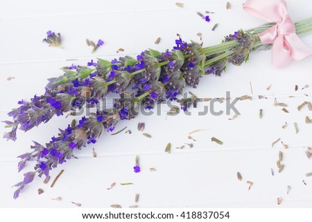 Fresh  cut lavender flowers  on white wooden table - stock photo