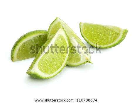 Fresh cut lime quarters - citrus fruit, isolated on white background with shadow - stock photo