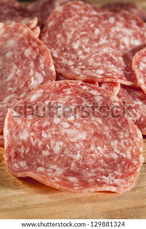 Fresh Cut Organic Salami against a background