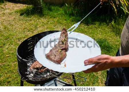 Fresh cut raw juicy beef meat steak seasoned with pepper and rosemarine - stock photo