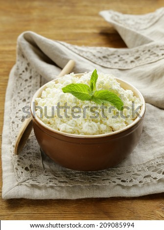 fresh dairy curd in a ceramic bowl, rustic style - stock photo