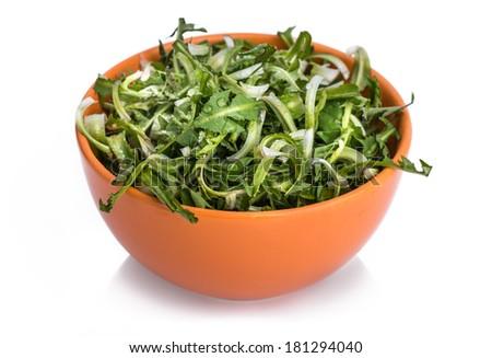 Fresh dandelion salad  Salad with fresh dandelion leaves, isolated on white - stock photo
