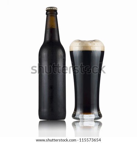 Fresh dark beer bottle and glass. - stock photo