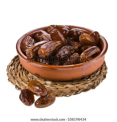 Fresh dates in ceramic bowl isolated on white background - stock photo