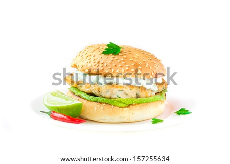 Fresh, delicious chicken burger in the Greek style with zucchini and yogurt cucumber sauce tzatziki, isolated on white - stock photo