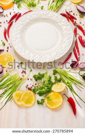 Fresh delicious herbs,spices and seasoning and empty plate on white wooden background - stock photo