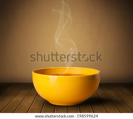 Fresh delicious home cooked soup with steam on wood deck - stock photo
