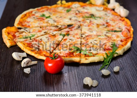 fresh delicious Italian pizza with mushrooms on thin crust - stock photo