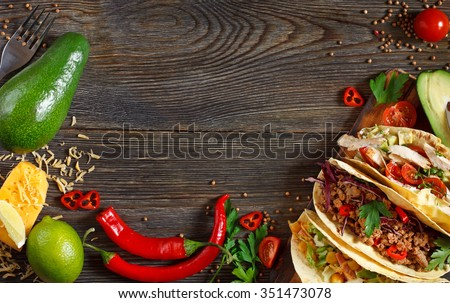 Fresh delicious mexican tacos and food ingredients.
