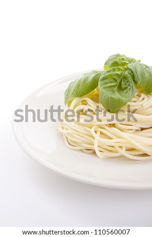 fresh delicious pasta with basil isolated on white background