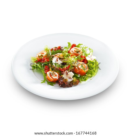 Fresh delicious salmon rolls with cream cheese on lettuce with button mushrooms on a round plate isolated on white. - stock photo