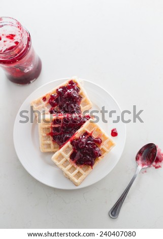 Fresh delicious waffles with cherry jam - stock photo