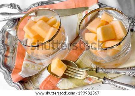 fresh dessert with melon and  with vintage silverware