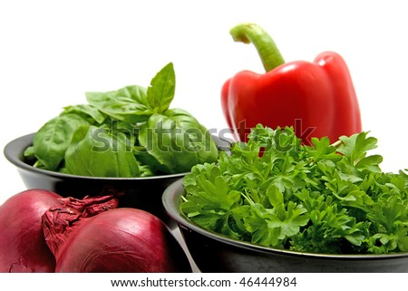 fresh dinner ingredients with basil, parsley, red onion and paprika over white background