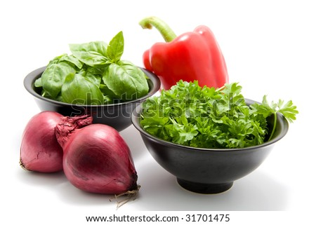 fresh dinner ingredients with basil, parsley, red onion and red paprika